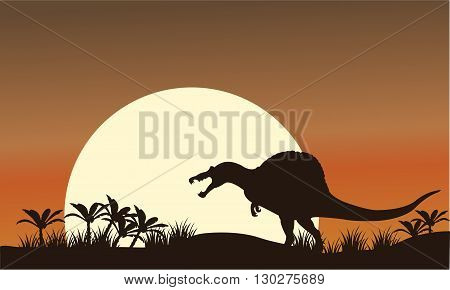 Silhouette of spinosaurus and big sun at the morning