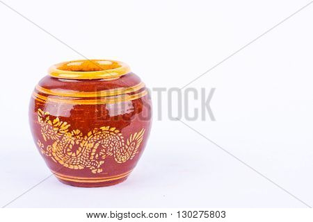 Glazed water jar with dragon pattern from Thailand for home interiors on white background