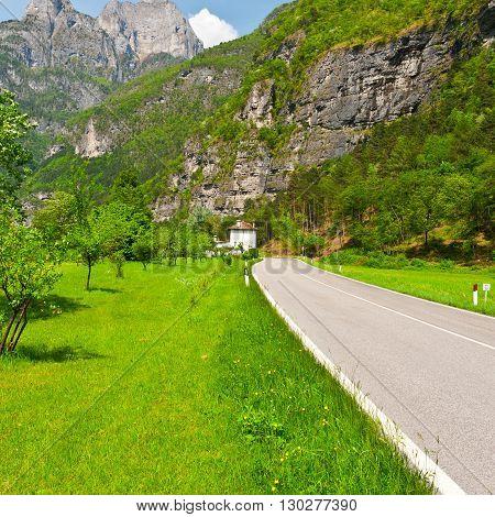 Asphalt Road in the Italian Alps in the Spring