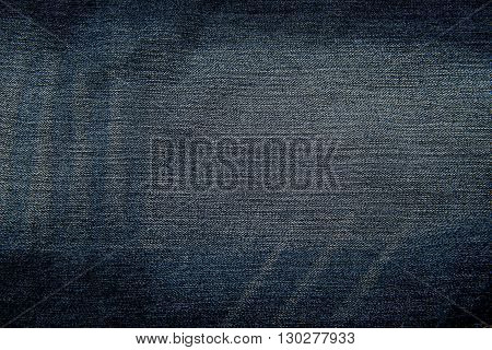 a texture of dark blue jeans background