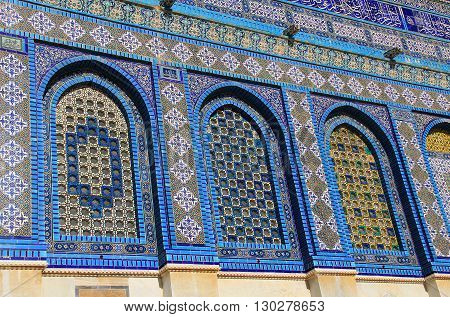 Close-up view of the intricate colorful mosaic tiles on The Dome of the Rock
