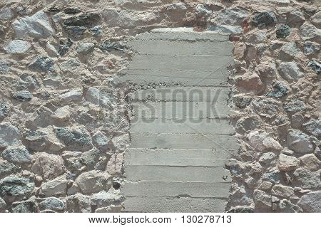 a picture of an exterior 1880's stone barn wall