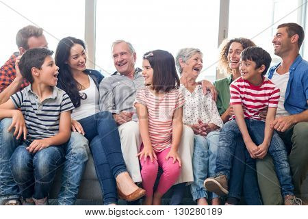 Happy family sitting on sofa in their living room