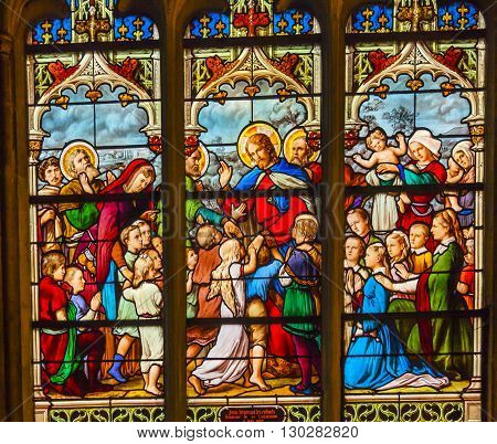 PARIS, FRANCE - MAY 31, 2015 Jesus Christ Children Suffer the Little children to come to me Stained Glass Saint Severin Church Paris France. Saint Severin one of oldest churches Paris located in the Latin Quarter. Built in the 1500s