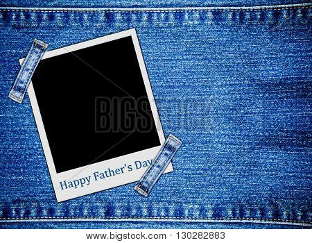 Happy father's day on blank instant photo frames on jeans background