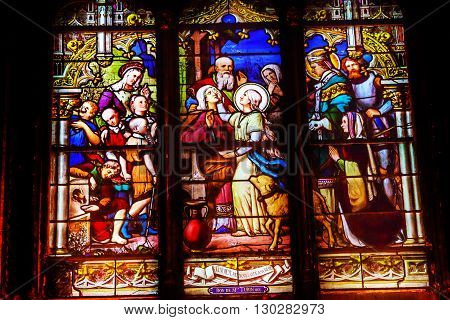 PARIS, FRANCE - MAY 31, 2015 Saint Genevieve Patron Saint of Paris Stained Glass Saint Severin Church Paris France. Saint Genevieve lived in Paris between 400 to 512AD. Saint Severin one of oldest churches Paris located in the Latin Quarter. Built in the