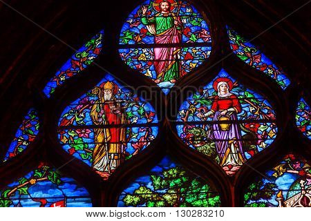 PARIS, FRANCE - MAY 31, 2015 Jesus Christ Bishop Stained Glass Saint Severin Church Paris France. Saint Severin one of oldest churches Paris located in the Latin Quarter. Built in the 1500s
