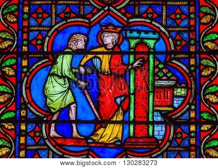 PARIS, FRANCE - MAY 31, 2015 King Sword Castle Medieval Stories Stained Glass Notre Dame Cathedral Paris France. Notre Dame was built between 1163 and 1250AD.