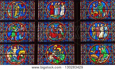 PARIS, FRANCE - MAY 31, 2015 Kings Saints Medieval Stories Stained Glass Notre Dame Cathedral Paris France. Notre Dame was built between 1163 and 1250AD.