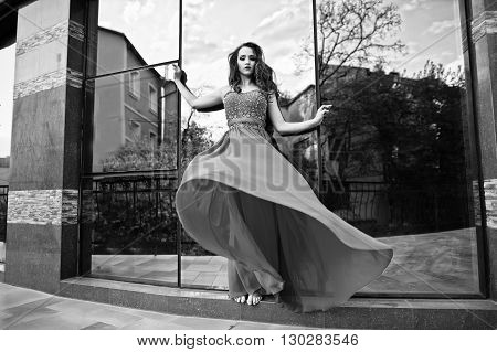 Portrait Of Fashionable Girl With Bare Feet At Red Evening Dress Posed Background Mirror Window Of M