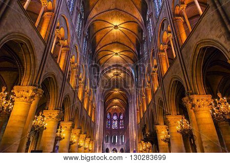 PARIS, FRANCE - MAY 31, 2015 Interior Arches Gothic Stained Glass Notre Dame Cathedral Paris France. Notre Dame was built between 1163 and 1250 AD.