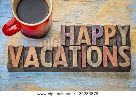Happy vacations  banner in vintage letterpress wood type with a cup of coffee