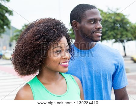 African american couple looking sideways outdoor in the city