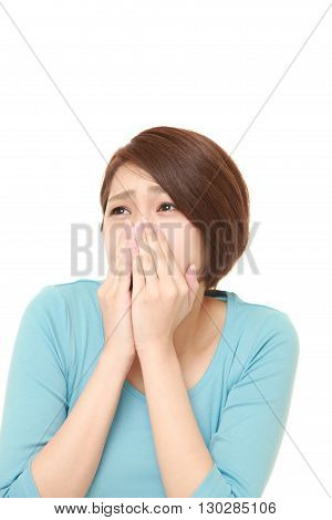 portrait of frightened woman on white background