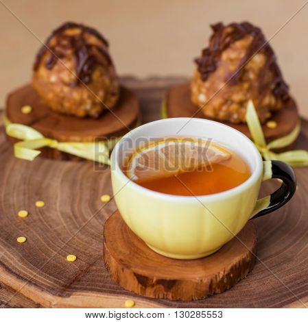 sweet little pastry with a mug on rustic wooden background
