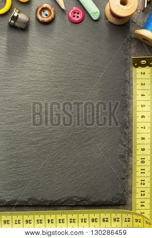 sewing tools and measuring tape on table background