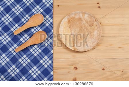 Tablecloth wooden spoon on wood textured background