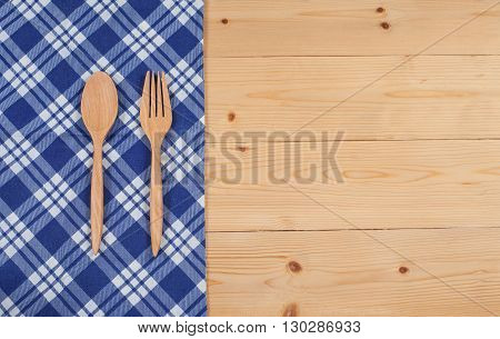 Tablecloth wooden spoon fork on wood textured background