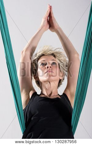 Single Woman Stretching With Aerial Yoga Blanket