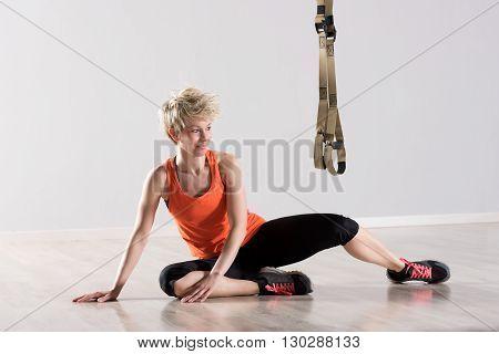 Woman Sitting Near Training Rings In Mid Air