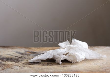 close up dirty white used tissue paper on wood table