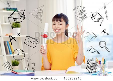 people, education, school, graduation and learning concept - happy asian young woman student with diploma scroll at home showing ok hand sign with doodles