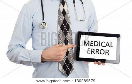 Doctor Holding Tablet - Medical Error