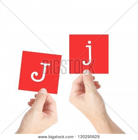 J written on cards held by hands