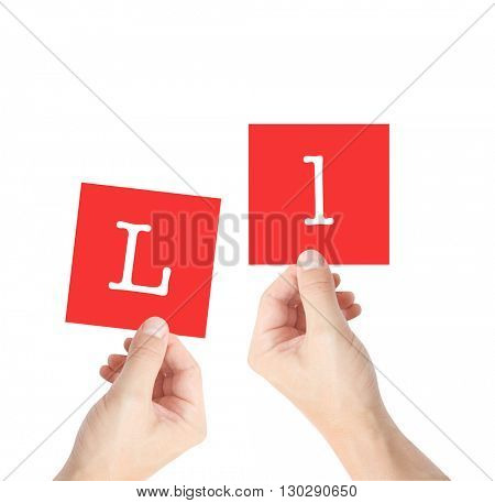 L written on cards held by hands