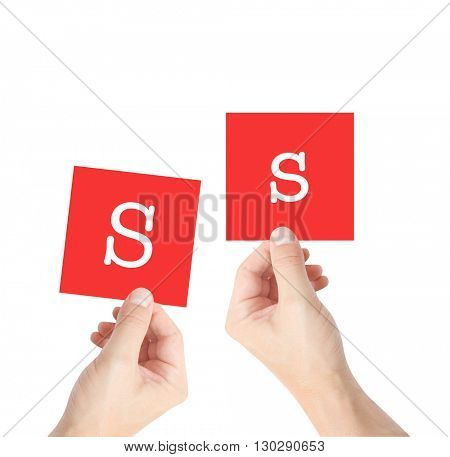 S written on cards held by hands