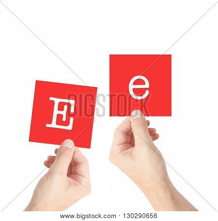 Ee written on cards held by hands