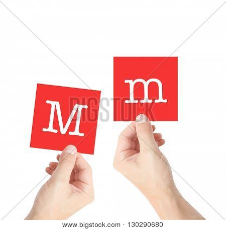 M written on cards held by hands