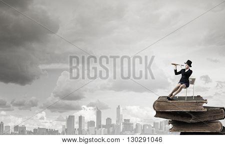 Girl in black cylinder