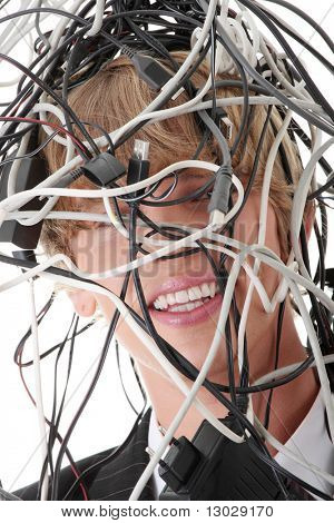Businessman wrapped in computer cables