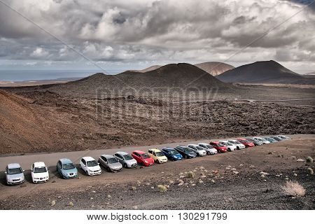 Lanzarote Spain - October 26 2012: Cars are parked at the parking lot of the information center at Timanfaya Nationaal Park Lanzarote