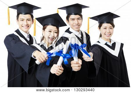 college graduates in graduation gowns standing and smiling
