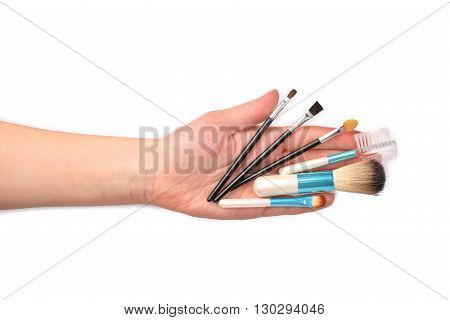 make-up items on hand isolated on white