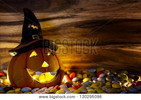 halloween pumpkin with witch's hat and chocolate candy candlelight