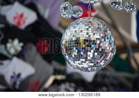 mirror ball on florence sign background close up