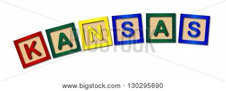 A collection of wooden block letters spelling KANSAS over a white background