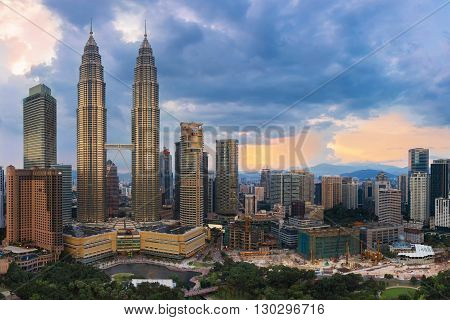 A view of the Kuala Lumpur city skyline with the Petronas Twin Towers and the KL Tower in the background on July 29,2015