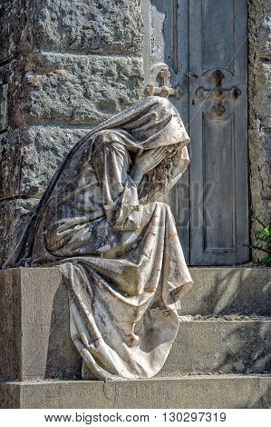 Widow Marble Statue Outside A Tomb