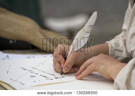 Hands Writing A Letter With A Plume