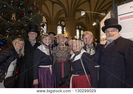 Hamburg - Germany - January 1, 2015 - Christmas Tree And People Singing In Rathaus