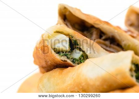 Delicious sliced puff pie stuffed with herbs and chicken eggs. Macro. Photo can be used as a whole background.