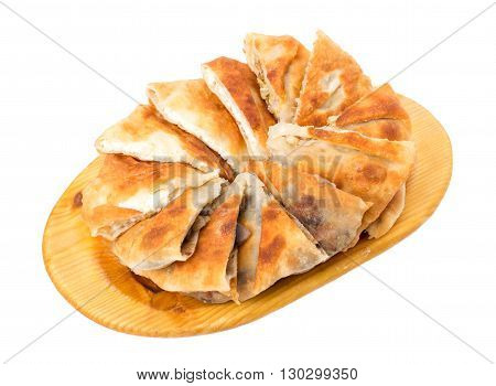 Delicious sliced puff pie stuffed with chicken breast and cabbage. Isolated on a white background.