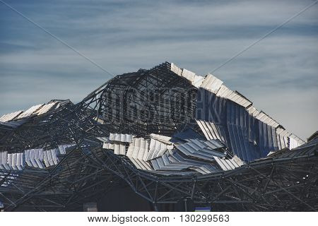 Destroyed metallic roof after hurricane view detail