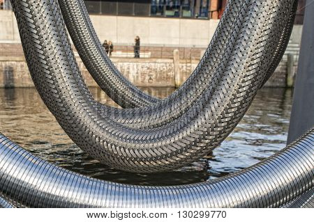 giant harbor metallic flexible pipe detail close up