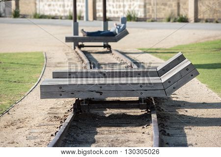 Wooden Chaise Longue On Rail Tracks
