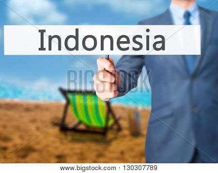 Indonesia - Businessman Hand Holding Sign